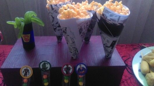 Cones made from comic book pages, great for holding zigzag ( the flash) chips. Superhero birthday party food ideas