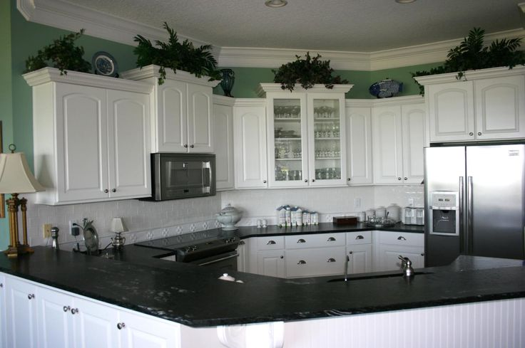 Loving the unique shape of this kitchen by Leverette Home Design ...