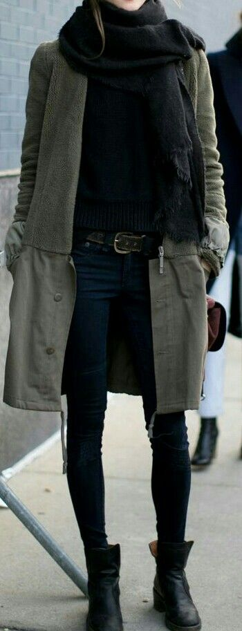 long olive green coat with all black outfit