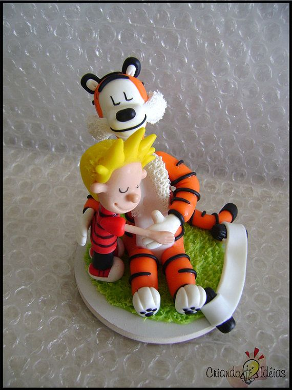 Calvin and Hobbes embrace by IdeasInColdPorcelain on Etsy, $50.00    Characters Calvin and Hobbes of the comic strip created by Bill Waterson, in classic pose!  Handmade work using cold porcelain (item made by comission).