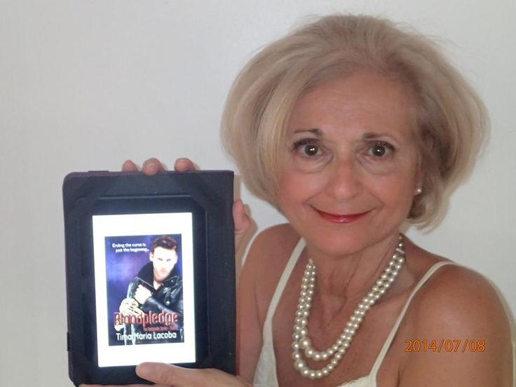My talented and beautiful friend, Lorraine with her copy of Bloodpledge.