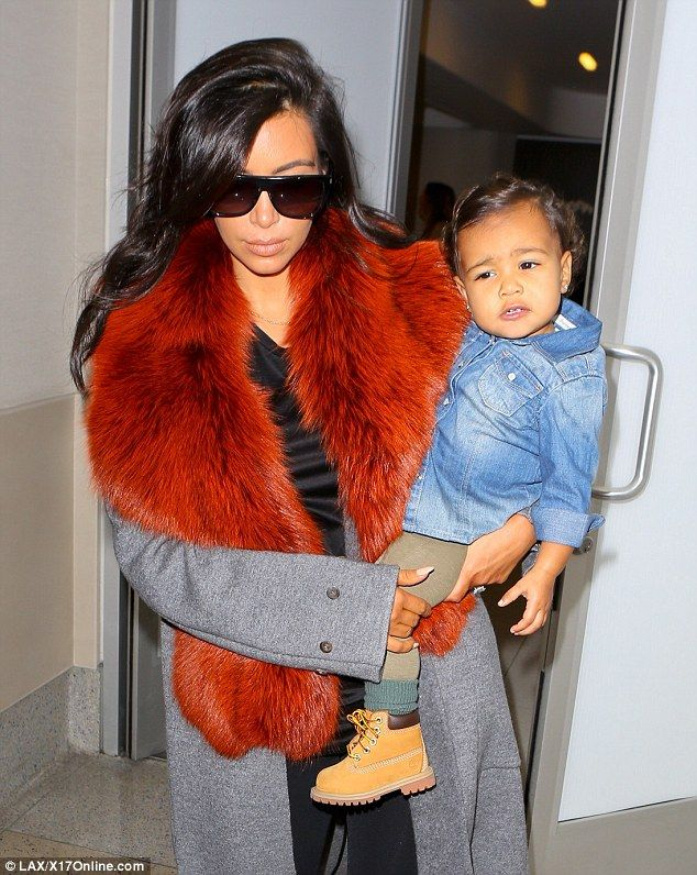 On their way to see Daddy: Kim and North were said to be headed to Chicago where Kanye West has been performing