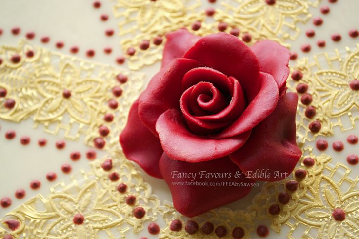 White chocolate, Red & Gold Asian/ Indian wedding cake chocolate rose close up | Fancy Favours & Edible Art -- #wedding #cake #Asian #Indian #indianwedding #asianwedding #gold #marsala #red #white #table #desserttable #tabledisplay #lace #jewelry #beaded #jewellery  #piping #elegant #floral #flowers #rose #petals #henna #sugarart #sugarflowers #ornate #fancy #ffeabysawsen #chocolate #whitechocolate  #handmade #custom #customcake #weddingcake #styled #weddingstyle