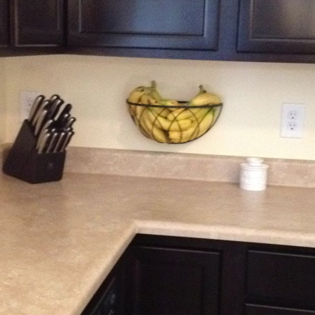 Hanging planter basket re-purposed as a fruit holder. Frees up counter space.