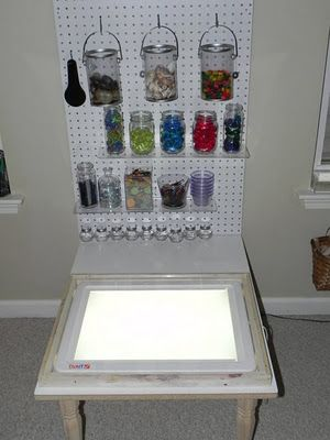 I like how the materials for the light table are hanging up on display. Seeing all of the possibilities laid out, so colorful that they double as decoration, is so inviting and will especially catch the eye of the more visually focused learners. I would have loved to have regular access to one of these when I was a kid.