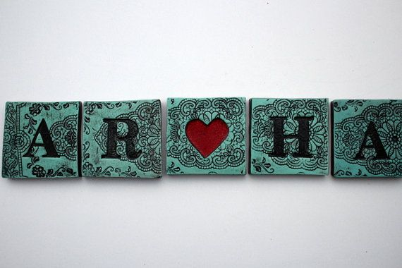 Set of five ceramic tiles, comes in either black and white or duckegg and white, both with a cadmium red heart. Stunning Individually Hand
