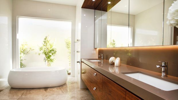 Relax and unwind in your sumptuous ensuite, complete with picturesque view...