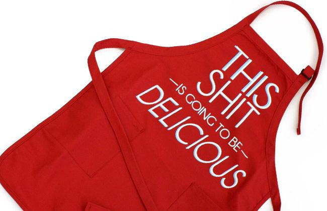 """Text on an apron: """"This shit is going to be delicious"""""""