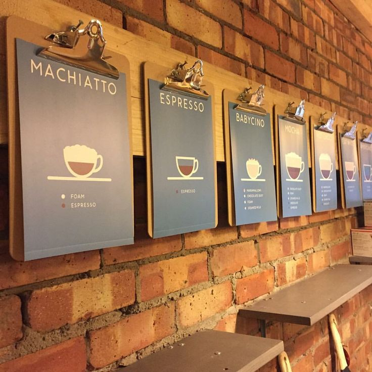 with clip boards explaining the different kinds of coffee ....on side wall by freezer  Coffee menu                                                       …