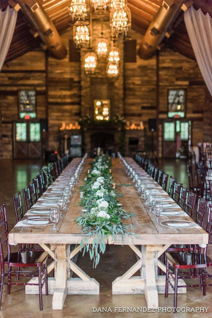 The beautiful farm house tables placed together to design the perfect head table @dfernandezphoto