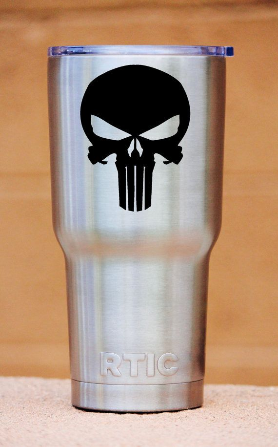 Custom Laser etched Punisher Skull Marvel Comics RTIC Tumbler  We promise all your friends will be asking you where got that awesome tumbler.  Why get a laser etch tumbler over a screen printed one? We custom laser etch each tumbler with a special chemical that burns the design permanently in black. This means you can wash it over and over and the logo will NEVER rub off. Screen printing can fade and chip off over time. Laser etching will be there for life!  About RTIC Tumblers: RTIC…