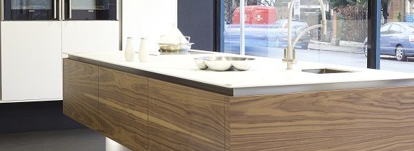 Real wood book-match veneer with Dekton work surface featuring Franke tap and sink against a backdrop of Mat Lacquer wall units