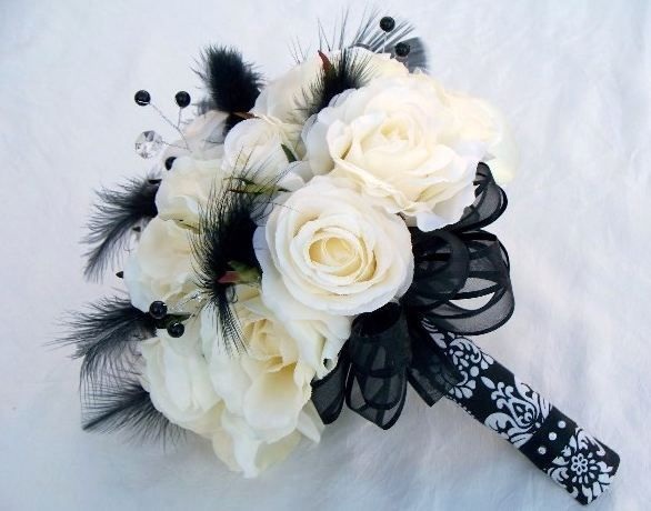 White rose bouquet with black feathers and diamante ...