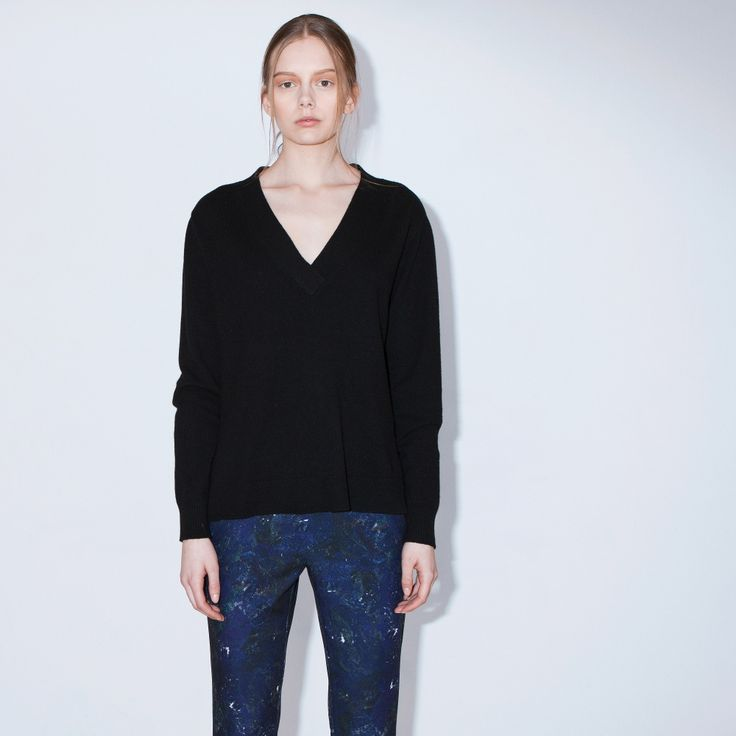 Ain't No Mountain is a soft, fine-knit sweater with a deep V-neck, ribbed trims and slit in side seams.
