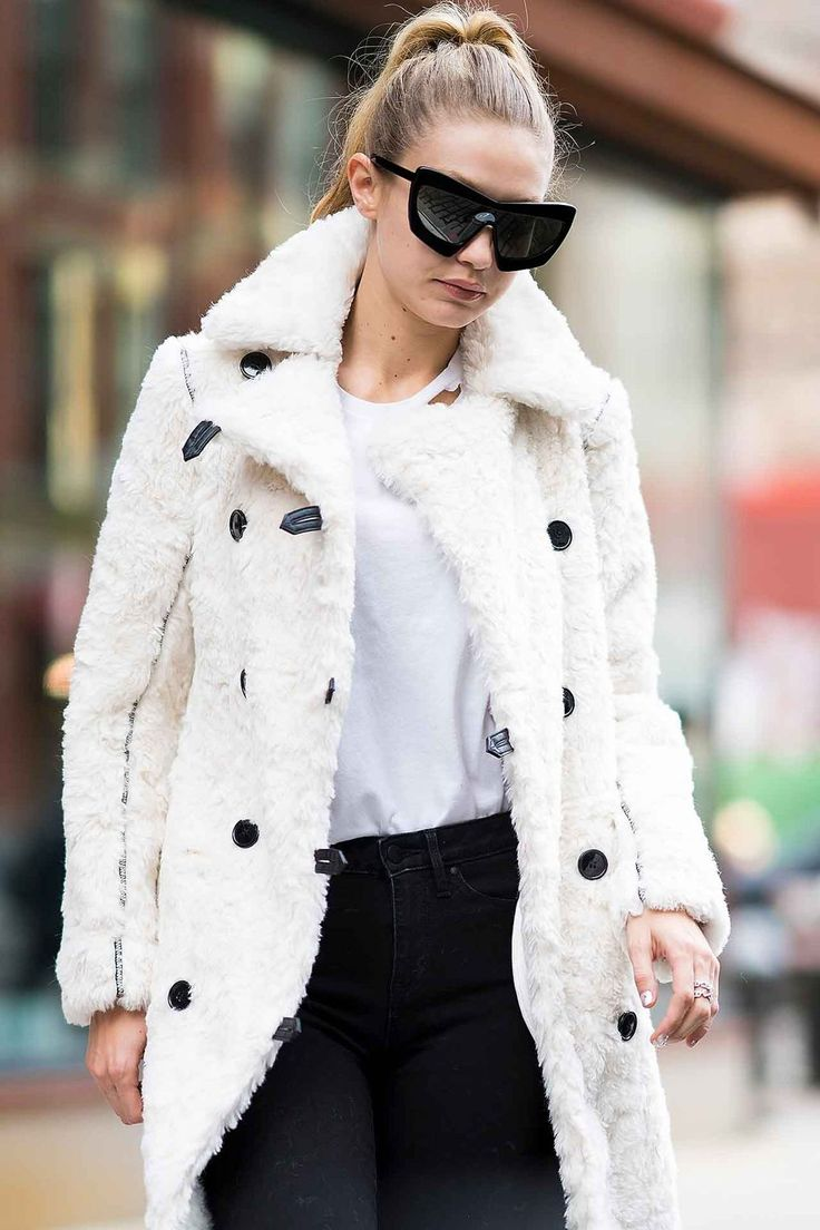 "[link url=""http://www.glamourmagazine.co.uk/person/gigi-hadid""]Gigi Hadid[/link] looked oh so cosy in a shearling coat and goggle-like sunglasses. We love this level of snug."
