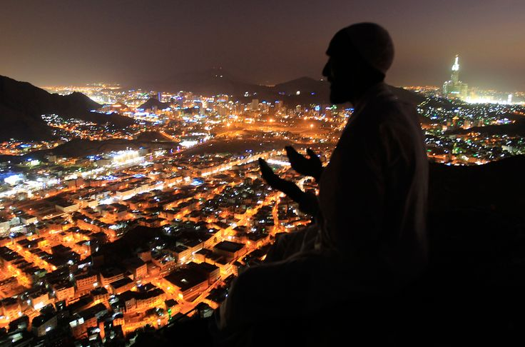 A Muslim pilgrim prays as visits the Hiraa cave at the top of Noor Mountain on the outskirts of Mecca, Saudi Arabia on November 2, 2011. According to tradition, Islam's Prophet Mohammed received his first message to preach Islam while he was praying in the cave. (Hassan Ammar/AP)