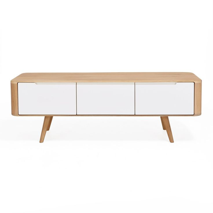 Crafted in Bosnia from solid oak, the cabinet is a contemporary take on a mid-century frame. Three white, soft close doors offer plenty of storage. Rounded edges and a natural wood finish honor simplicity.