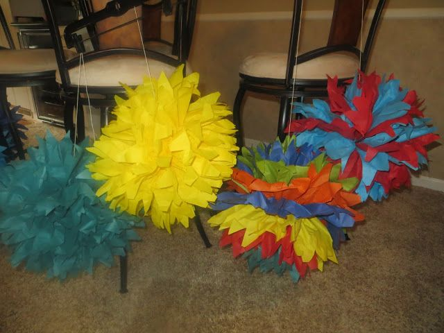 Inexpensive and easy to  make tissue paper Lorax trees for your next Dr. Suess party. Learn how.