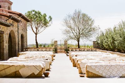 Linen-lace-coverd-hay-bales-wedding-ceremony-seating