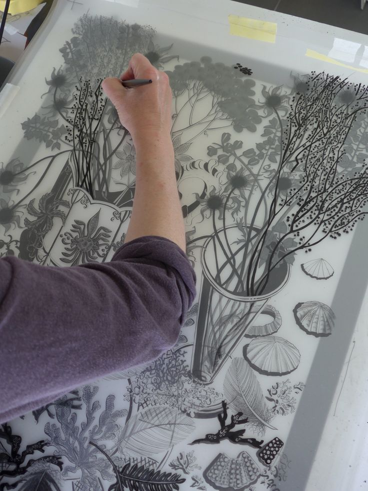 Angie Lewin works on the hand drawn and painted separations used to create her…