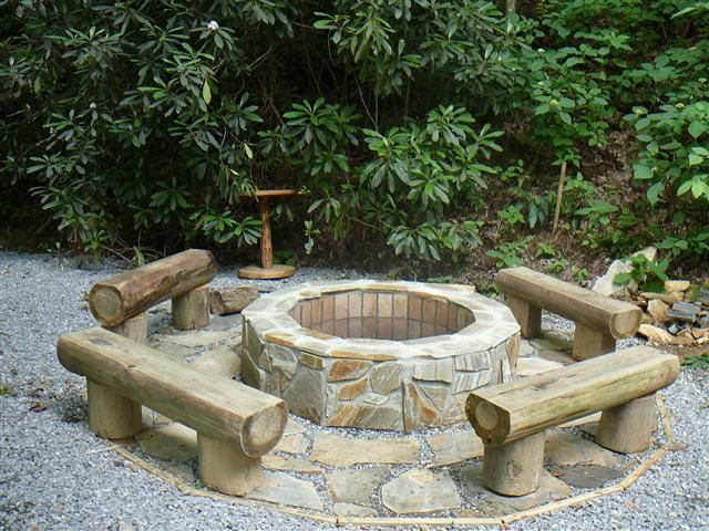 log seats around fire pit (but stained pretty and logs split in half verses slightly cut on the top. leave bark on.