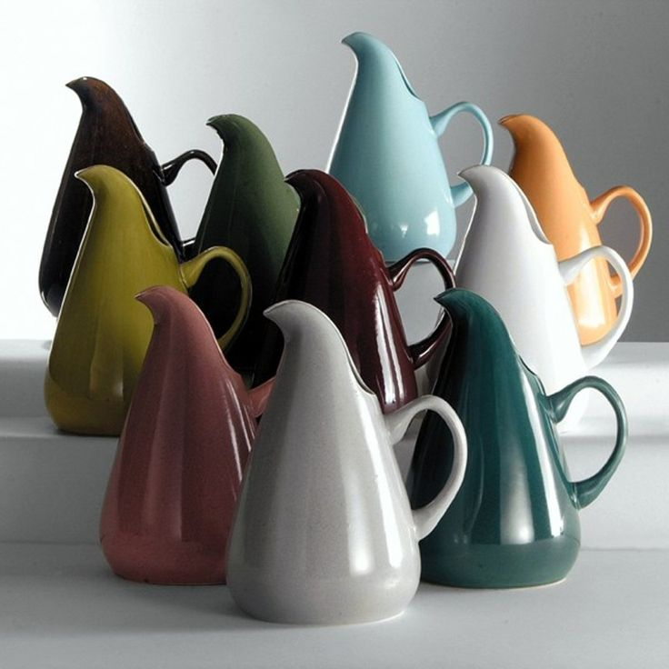 American Modern Water Pitchers designed by Russel Wright, 1939: Wright-designed American Modern pitchers in the ten colors produced: Back row: black chutney, cedar green, glacier blue, cantaloupe. Center row: chartreuse, bean brown, white. Front row: coral, granite gray, seafoam. Credit: MASCA, Photographer/Courtesy of Manitoga/The Russel Wright Design Center