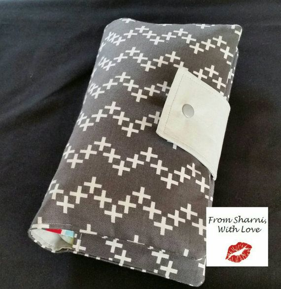 Check out this item in my Etsy shop https://www.etsy.com/au/listing/263229816/nappy-wallet-grey-and-white-crosses