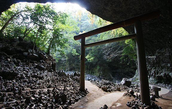 "Amanoiwato shrine, Takachiho where according to legend, Amaterasu, the Shinto sun goddess, became so outraged by her brother's cruel pranks that she hid herself in a cave, refusing to come out and depriving the world of her life-giving light. (the story behind the song ""Kagura"")"