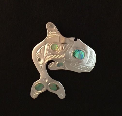 Whale Pendant with abalone inlay by Barry Wilson (Haisla).