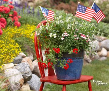 Colorful Container Garden. Red chair, pretty container flowers and an American flag.
