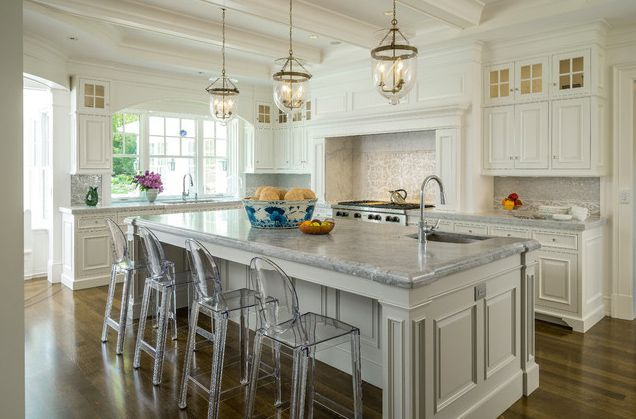 Ghost chair in kitchen by Architectural Kitchens