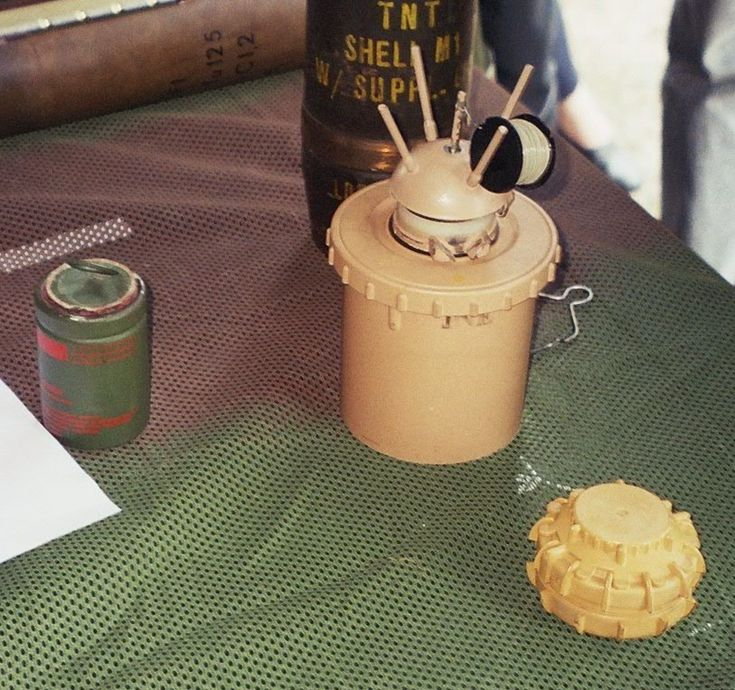 Examples of anti-personnel mines. Center: Valmara 69 (a bounding mine); right: VS-50