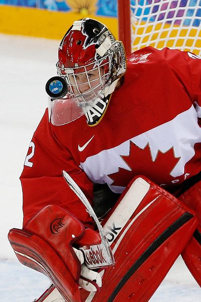 Charline Labonte of Canada keeps an eye on the puck 2-12-14