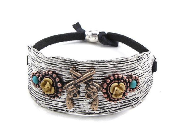 Antiqued metal bracelet in silver with copper accents features an gold cross gun