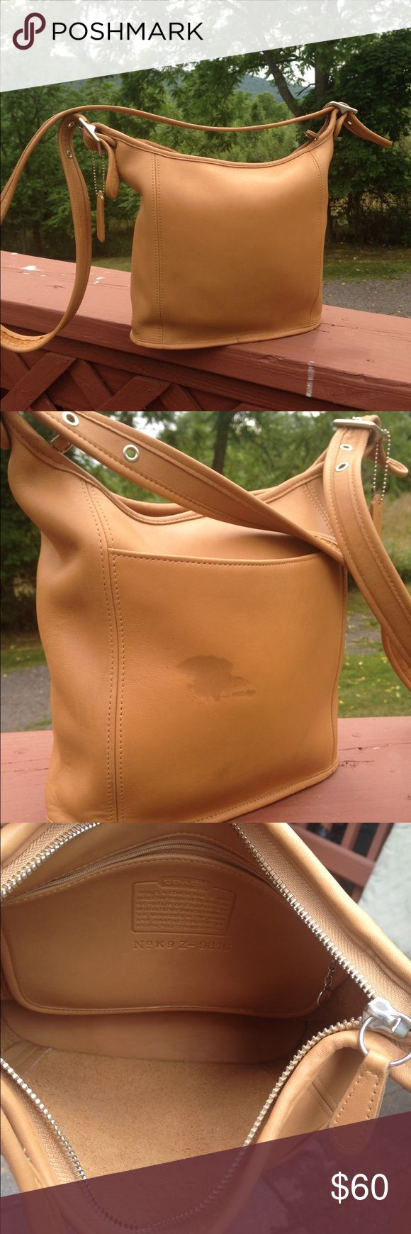 """Vintage Coach Camel Glove Leather Slim Duffle Cross Body handbag. Pre owned used condition. Outside of purse stain/scuff see picture.  Few minor scuffs here or there but purse generally in great condition. Creed# K9Z-9816. Made in Dominican Republic. Open pocket outside of purse.  Zipper pocket inside purse. Strap drop 22"""" purse size 9""""x9.5"""". Adjustable strap. Front pocket width 8"""".  Classic vintage coach bag!!! Color is so vintage!!! Coach Bags Crossbody Bags"""