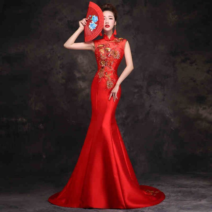 Fabric:Red satin Features:Sleeveless; stand up mandarin collar; Floor length small tailing mermaid dress; hand made Chinese fabric frog buttons; golden and red flowers embroidered on the shoulde...