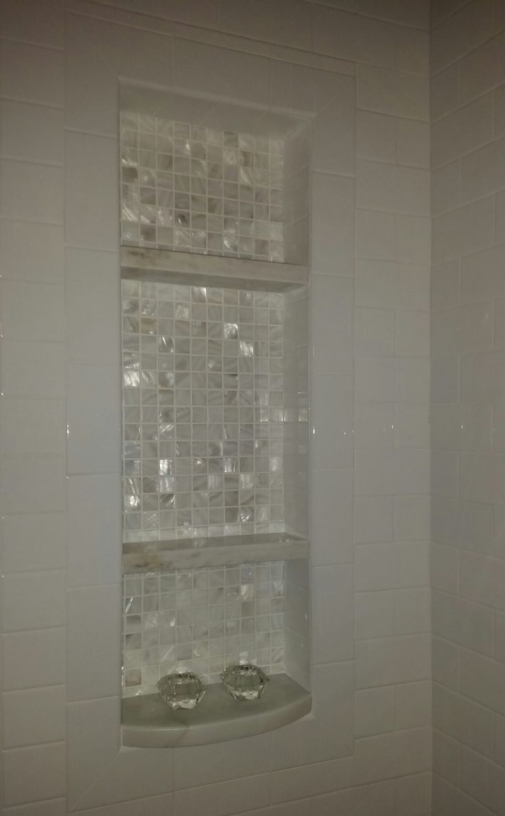 We added this niche to the tub/shower combo.   The shelves are calcutta marble and the backdrop is mother of pearl.