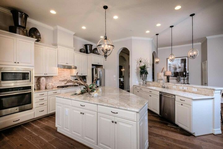 The flooring is Andalusia Oak 7 ½ inch Bodega Level 6. Love the white cabinets, countertops, and stone backsplash!!!
