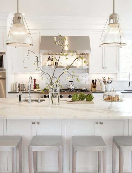 White and grey kitchen | www.themoderncool.com like the hood fan idea