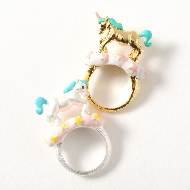 Add a touch of magic to your outfit with these **Unicorn Rings** by **gargle.** Two colors are available: **silver** (w/ warm yellow details and a pastel blue mane) and **gold** (w/ pastel pink details and a pastel teal mane). Each ring is a **Japanese size 10**. Matching Unicorn Necklaces are also available to complete the cute fantasy look.