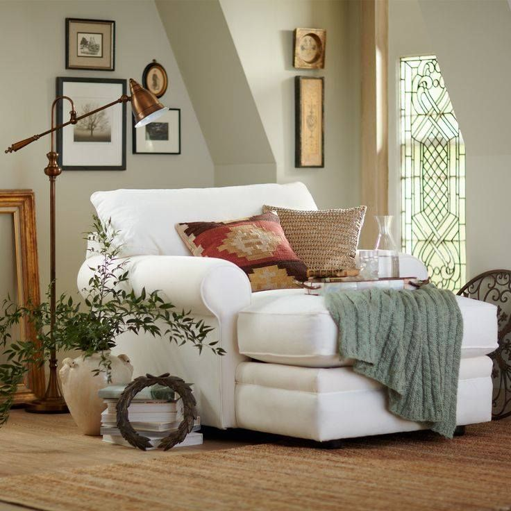 gorgeous extra wide & long chair with cozy throw, cushions and beautiful accessories <3