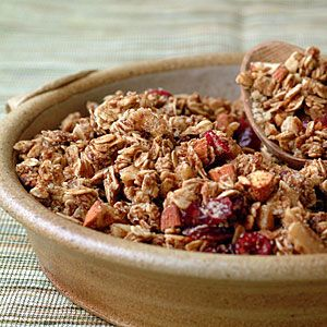 my go-to granola recipe . . . i usually double the recipe, omit the flaxseed, use a combo of walnuts and pecans (using more than recipe calls for), use about 1/2 the amount of brown sugar called for (if any) & omit cranberries to cut down on sugar (unless I have some sweetened with apple juice from whole foods). bake on parchment paper - no cooking spray needed. may need to bake at higher temp or for longer time depending on oven. will crisp up as it cools.