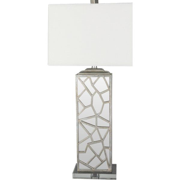 Update your design with the Woodmere collection's broken mirror illusion base and clean lines.