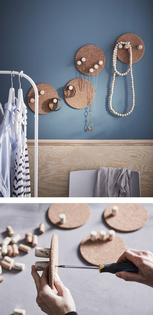 Old corks screwed into cork pot stands to make jewelry storage that hangs on a wall – via IKEA UK.