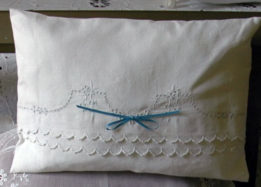 vintage linen ideas; I've done this.  It leaves the original pillow case intact.