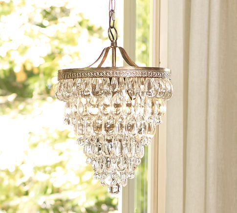 Clarissa light from Pottery Barn. Better fit for the eating area in the kitchen