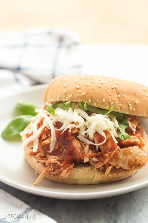 A SUPER simple, flavorful meal with just a few ingredients! These Slow Cooker Italian Chicken Sandwiches are perfect for summer picnics, busy weeknights.