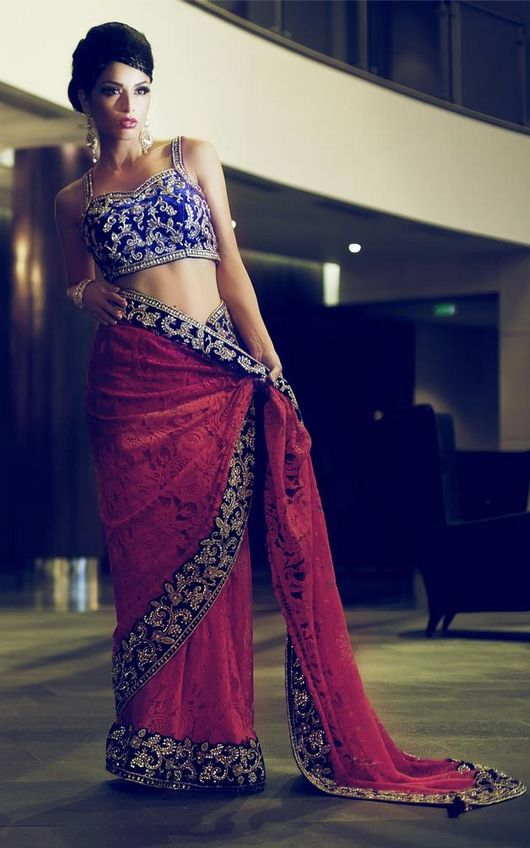 Dark Red #Saree With Blue Embroidered #Blouse By Mongas.