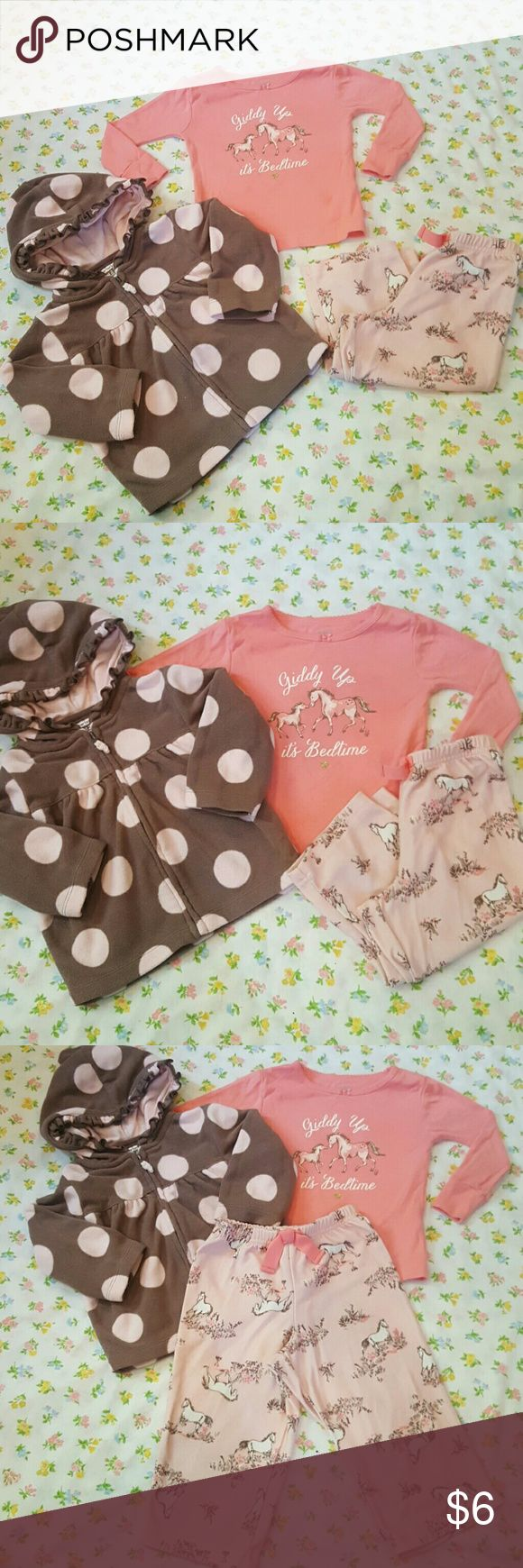 Carter's pony pajamas and polka dot hoodie Adorable soft and cozy baby girl pony pajamas by carter's size 18m but fits more like 12m comes with soft cozy adorable brown and pink polka dot Carter's zip up hoodie size 12m . Used but still very wearable condition. Carter's Pajamas Pajama Sets