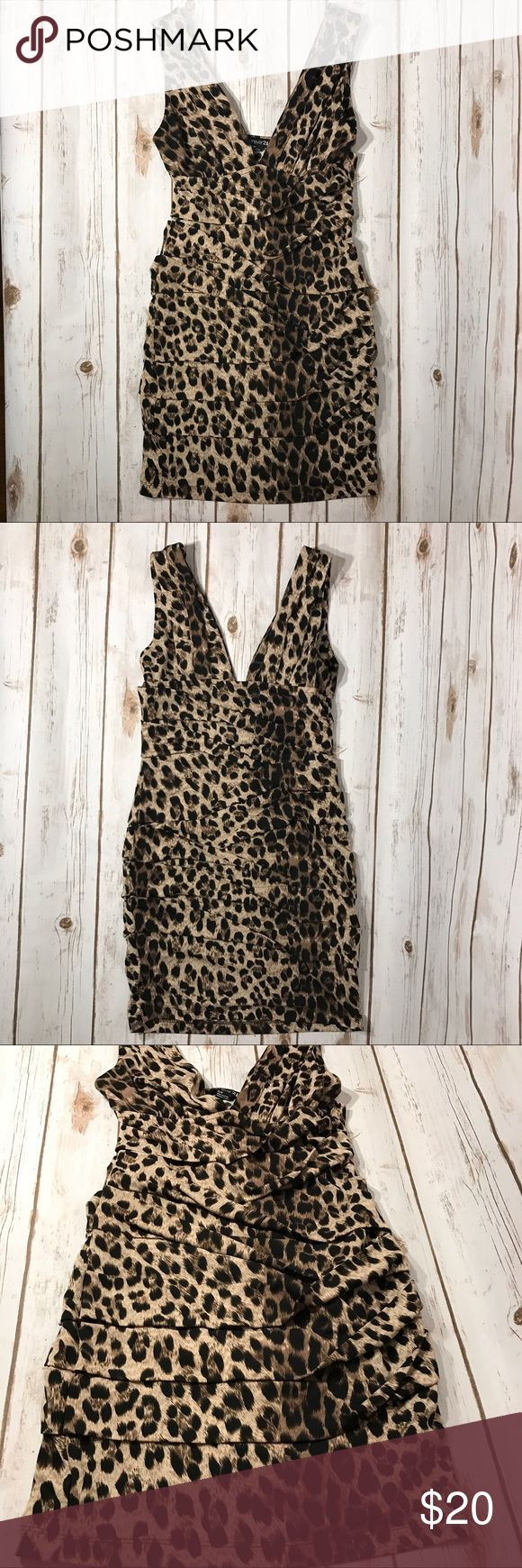 """Forever 21 Animal Print mini dress Gorgeous Forever 21 Sleeveless with overlapping layers Animal Print mini dress.  In good condition. No stains or rips. Size small. Measurements for flat lay: Shoulder to Shoulder (11"""") Armpit to Armpit (13.5"""") Top to Bottom (31"""") forever21 Dresses Mini"""